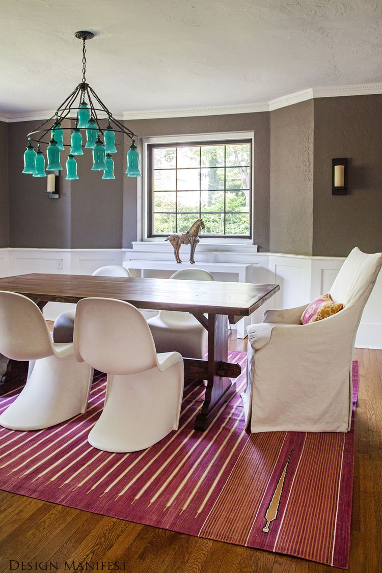 A Modern Bohemian Dining Room By Design Manifest Pink Rug Blue Chandelier Gray
