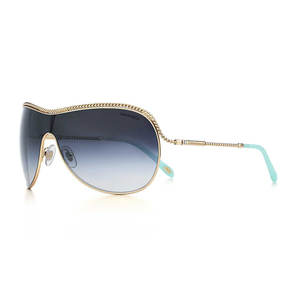 27a561356853c Tiffany Twist shield sunglasses in pale gold-colored metal and acetate.  290