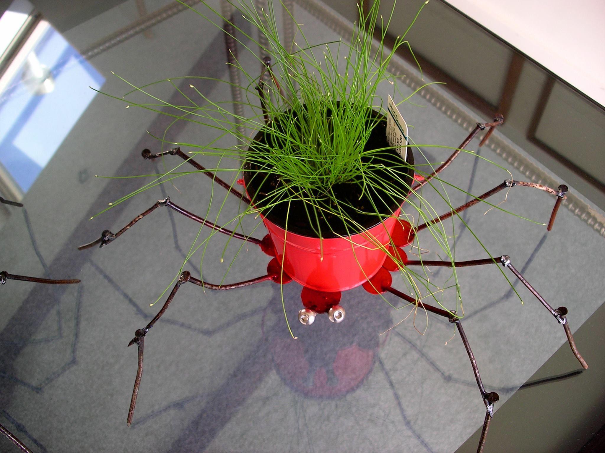 potplant holder made of nails and scrap metal