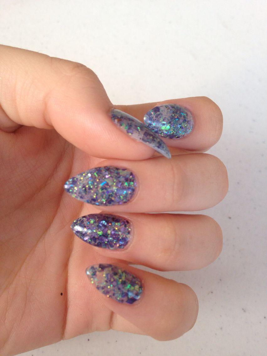 Blue glitter acrylic, almond shaped nails.