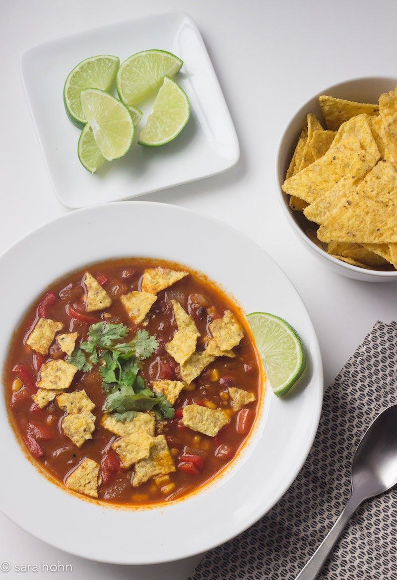 This brightly-flavored tortilla soup is easy to make and packed with delicious spices. Use store-bought tortilla chips for a quick weeknight meal.