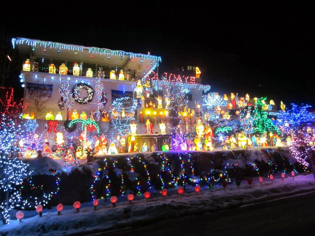 Frosty\'s Winter Wonderland is a huge light display. A family fills ...