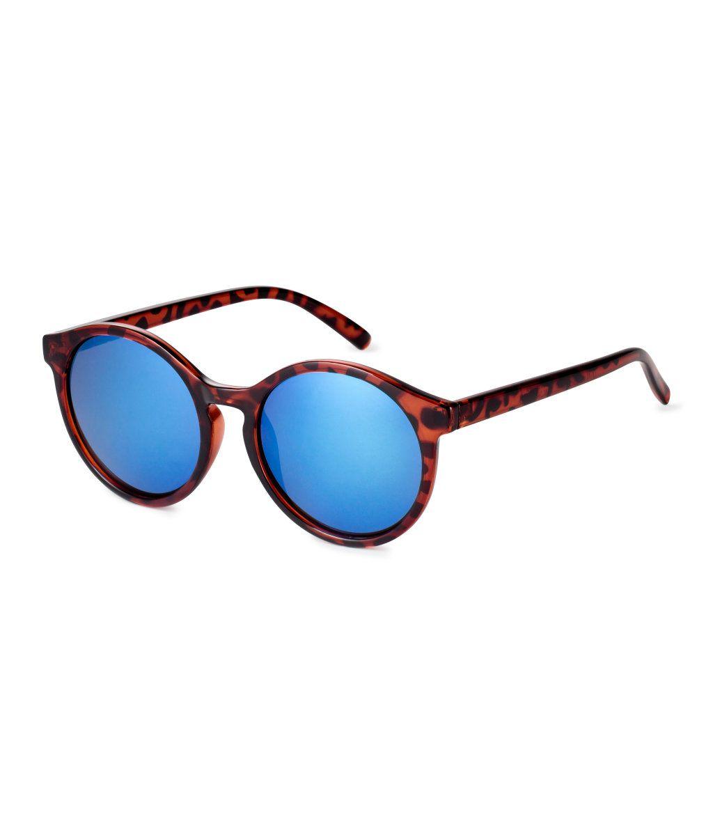 Skildpaddemønstret. Solbriller i plast med tonede glas og UV-beskyttelse.