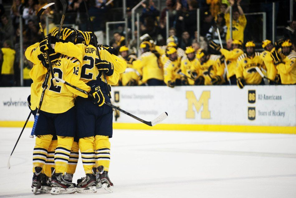The Michigan Hockey Teams Celebrates After Freshman Defenseman Jacob Trouba Scores In The Third Period Of The Game Against We Michigan Hockey Hockey Ice Hockey