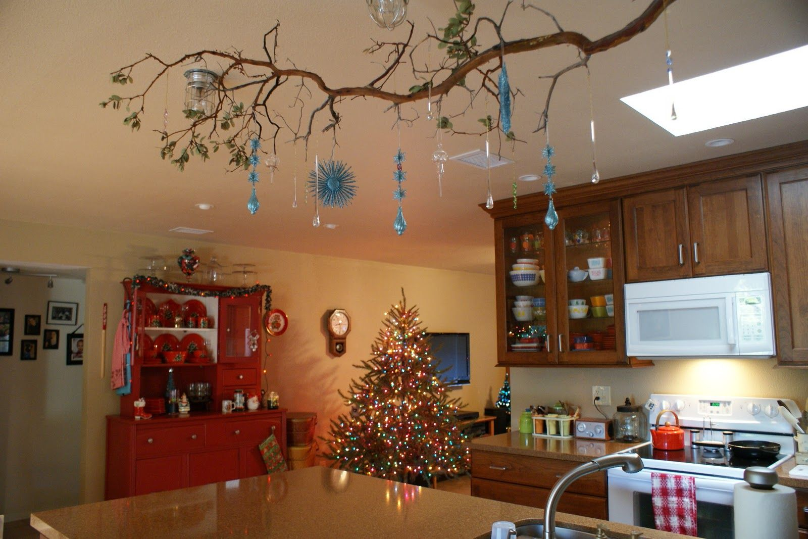 Hang Branches From The Ceiling With Fishing Wire And Decorate With Whatever You Choose Description From Pint Tree Branch Decor Christmas Branches Branch Decor