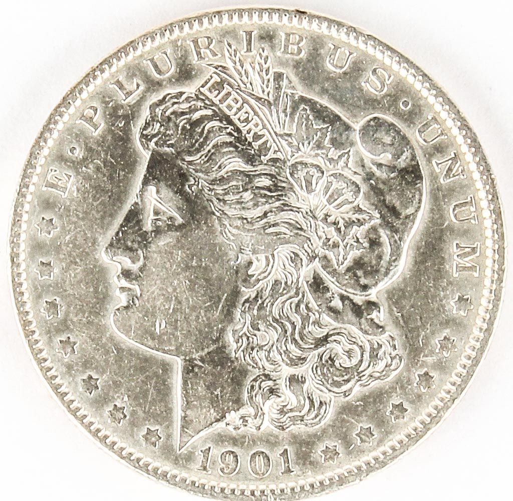 "Lot 21 in the 8.18.15 online & live auction! 901-P Morgan Silver Dollar is 26.73g of 90% Silver, Philadelphia minted 6,962,000. Hard to find extremely rare date coin is in consignor graded in ""Nice"" condition. #Coin #Collect #Shopping #Money #Currency #POGAuctions"