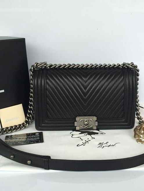 This New Medium Chevron Boy bag marries rich black lambskin leather with  aged ruthenium hardware. 4570be34a770a