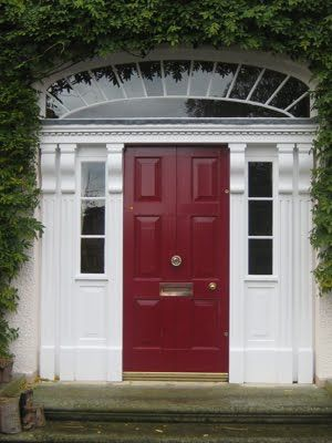 Dark Red Front Door i like that the sidelights start halfway up, blocking the view of
