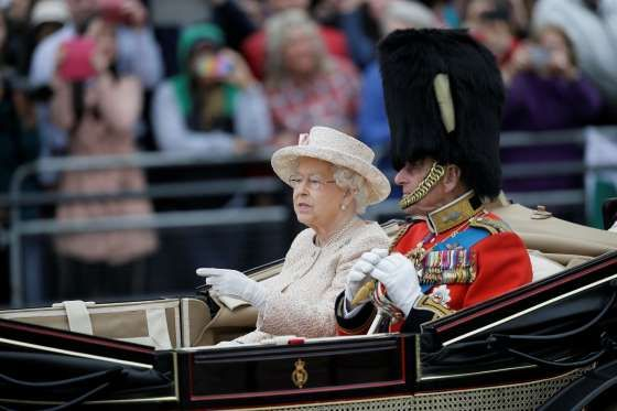 June 13, 2015 | The Queen and Prince Philip ride in a carriage during the Trooping The Colour parade at Buckingham Palace in London on June 13, 2015 | Tim Ireland/AP Photo