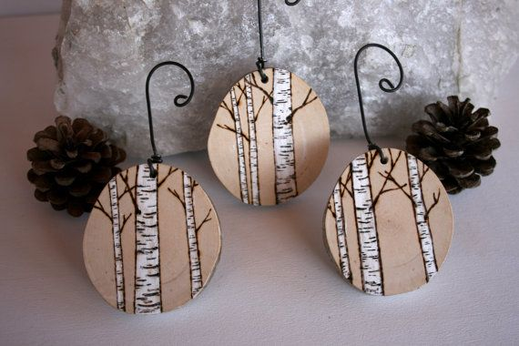 A set of handmade, woodburned (with snowy white paint accents ...