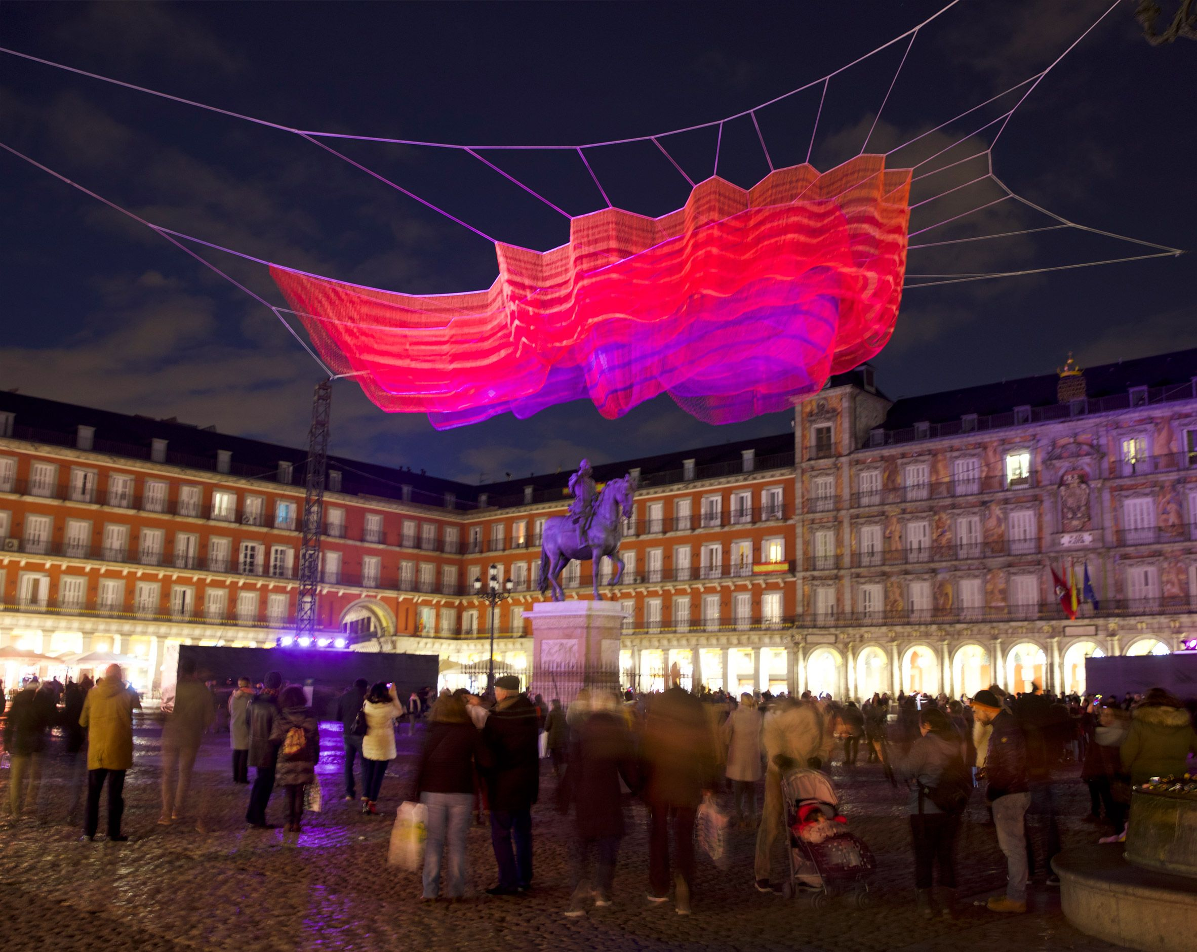 Janet Echelman installs huge netted sculpture above Madrid's Plaza Mayor