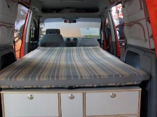 A Cozy Twin Bed In Mini Camper Van Conversion