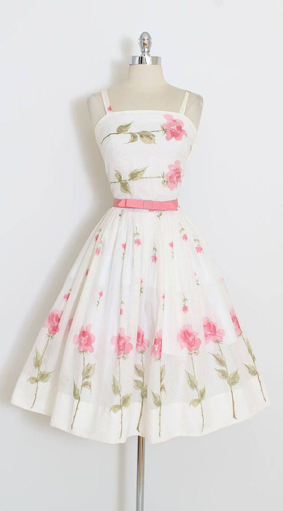 ➳ vintage 1950's dress * beautiful pink rose print * semi-sheer swiss dot cotton * lined bodice * metal side zipper * snap closure bow tie belt * by Jo Collins condition | excellent fits like xs/s length 43 bodice 17 bust 32-33 waist 25-26 finished hem allowance 4 ➳ shop http://www.etsy.com/shop/millstreetvintage?ref=si_shop ➳ shop policies http://www.etsy.com/shop/millstreetvintage/policy twitter | MillStVintage facebook | millstreet...