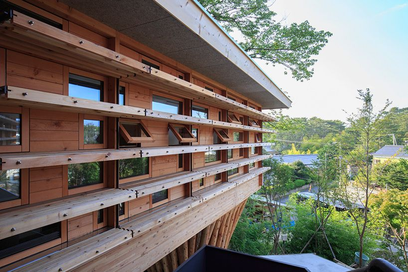 life style koubou embeds timber dwelling into japanese hillside
