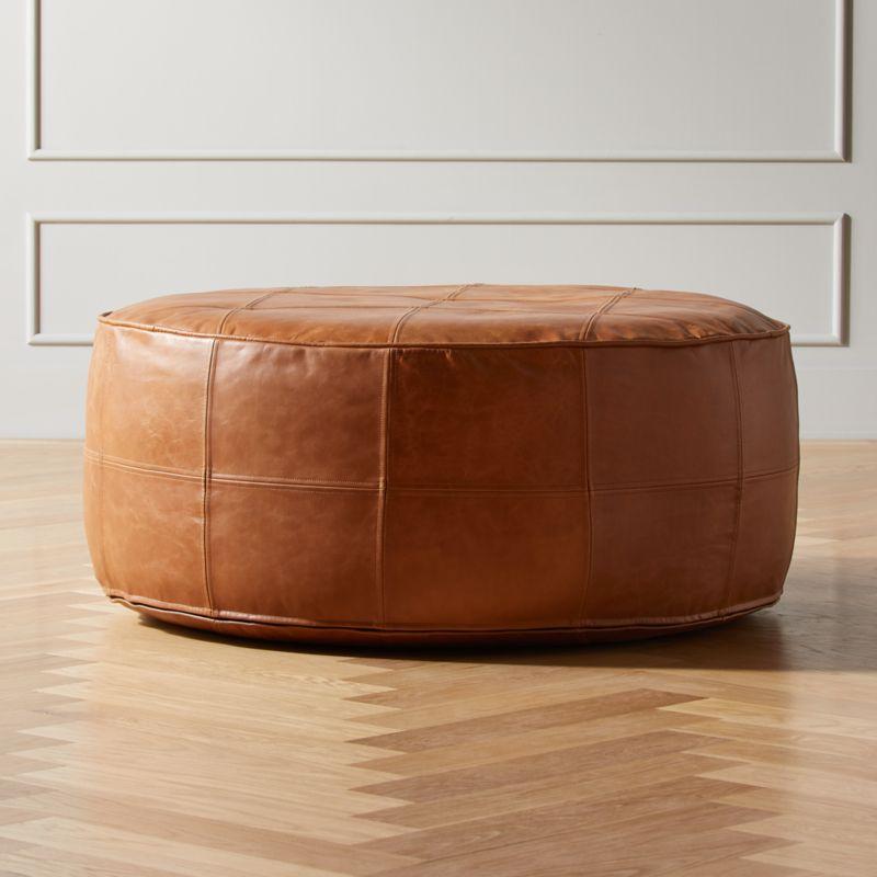 Round Saddle Leather Pouf Ottoman Reviews Cb2 In 2020 Leather Pouf Ottoman Leather Pouf Leather Ottoman