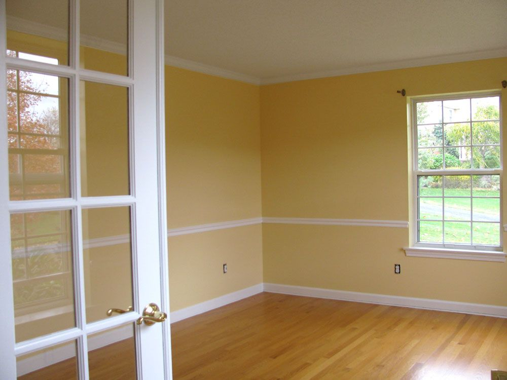 Mellow Yellow Living Room With French Doors Chair Rail And Crown Molding Painted By Phoenix Painting Of Greater Yellow Living Room Yellow Walls House Painting