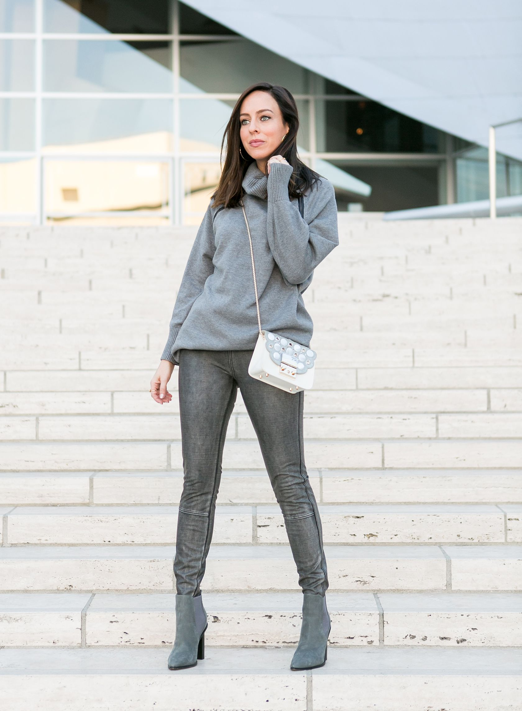 5a8b3f14f94e3 Sydne Style shows how to wear leather leggings in lysee silver pants #gray  #falloutfits #silver #metallics #turtleneck #leatherleggings