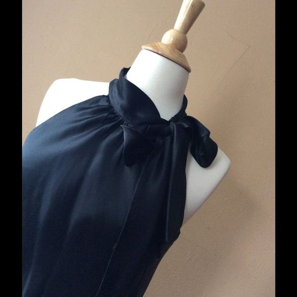 Black halter blouse with tide bow on neck Black halter blouse with tide bow on neck 100% polyester silky feeling lined INC International Concepts Tops Blouses