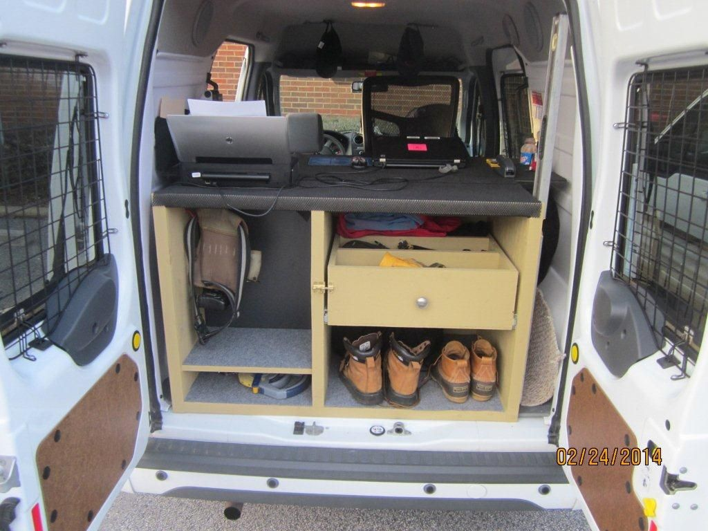 Here is a driver s great modification to the 2013 ford transit connect mobile office van desk