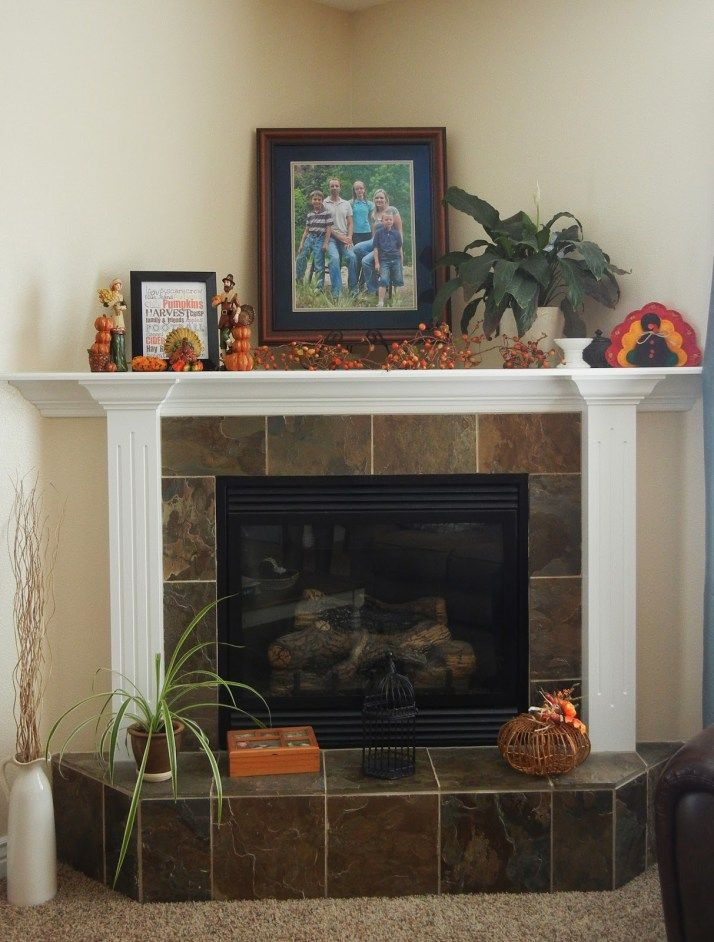 How to and how not to decorate a corner fireplace mantel Corner fireplace makeover ideas