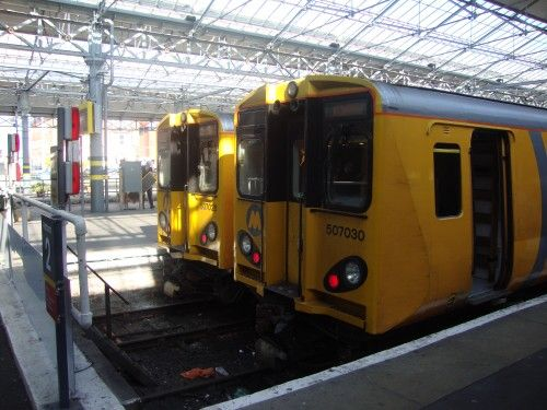 The sun shines down into Southport station onto two Mersyrail class 507 units 17.4.2012