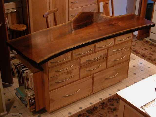 Rustic Kitchen Island with Walnut Slab top, curly maple base and brushed  nickel drawer pulls