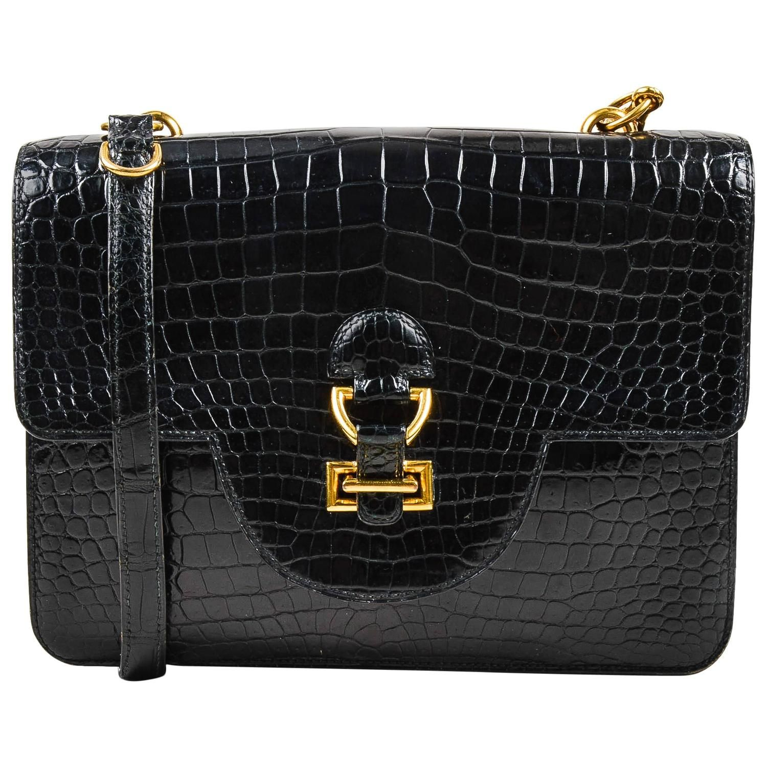 For Sale on - Beautiful  Sandrine  shoulder bag circa 1986 constructed of  timeless black crocodile leather with a glossy finish. Flap with. Vintage  Hermes ... 76ab33bc22754