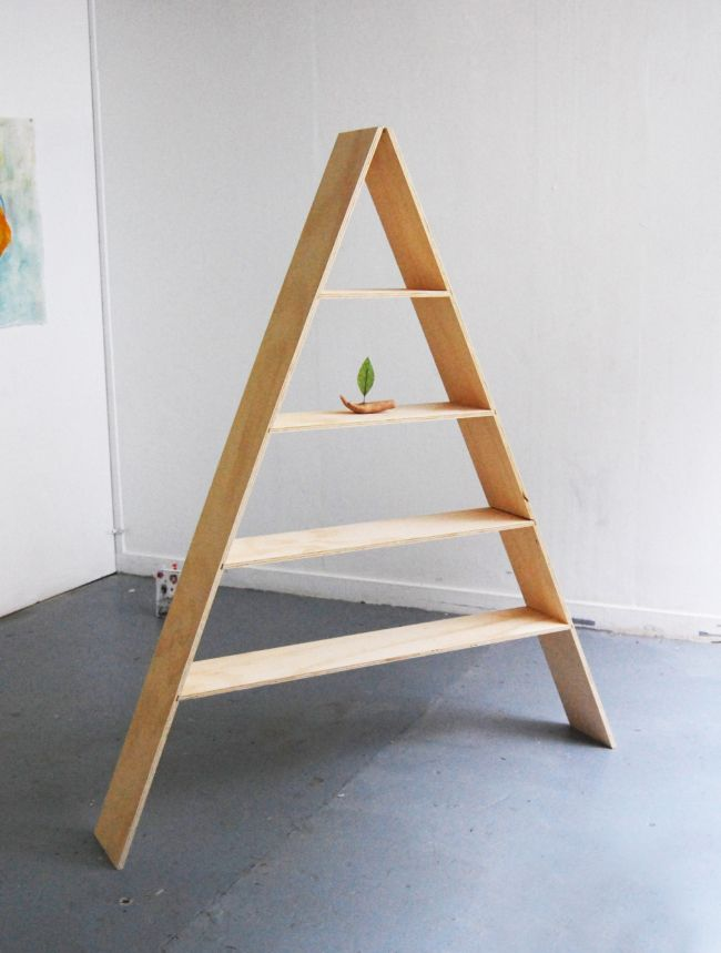 Pyramid shelf, plywood. Shelves slide out and sides fold together to disassemble.