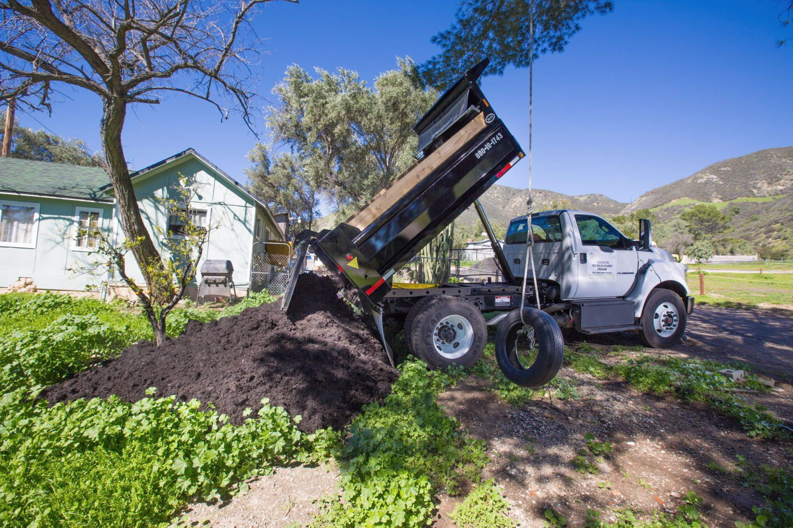 Truck Dropping Off Mulch Outdoor living, Mulch, Outdoor