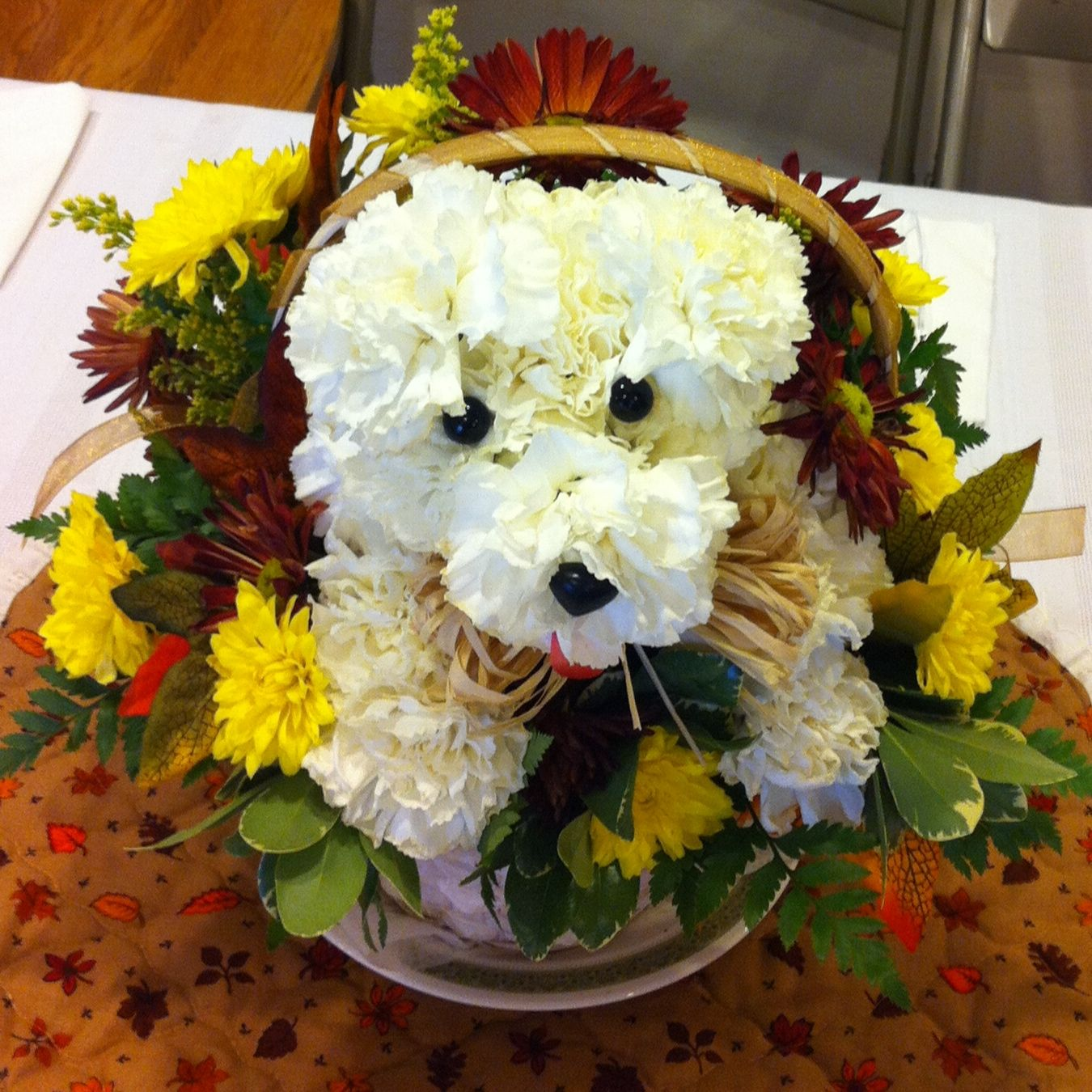 A puppy dog centerpiece made from carnations adorable home flower izmirmasajfo Gallery