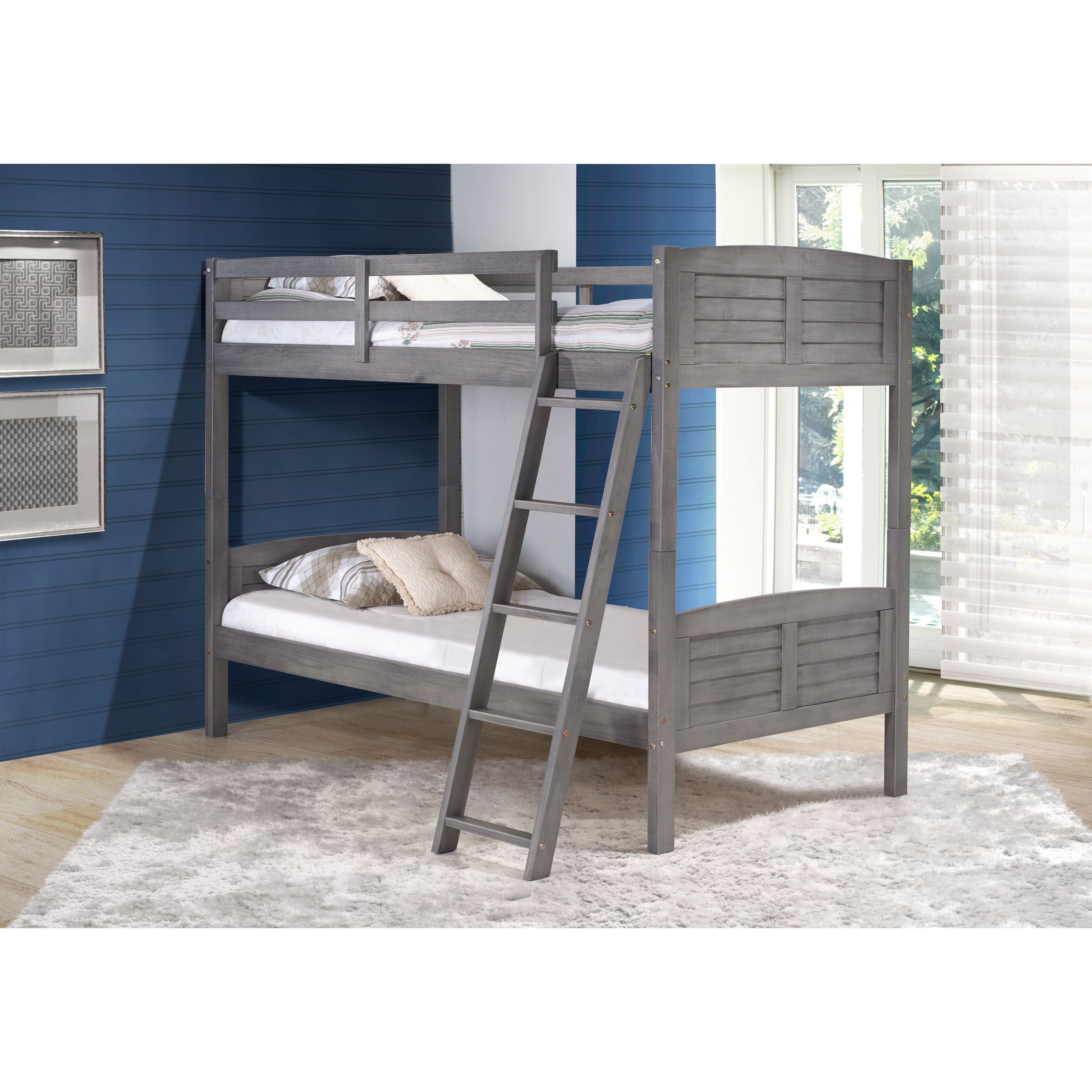 Loft bed with desk on bottom  With a twin bed on bottom and top this Donco Louver Bunk Bed has a