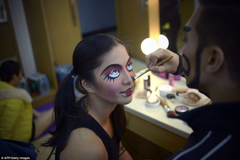 Dancers get ready backstage, where they were treated to dazzling and colourful makeovers...