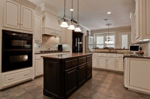 black appliances, cream cabinets, and a black island?! i love. | for