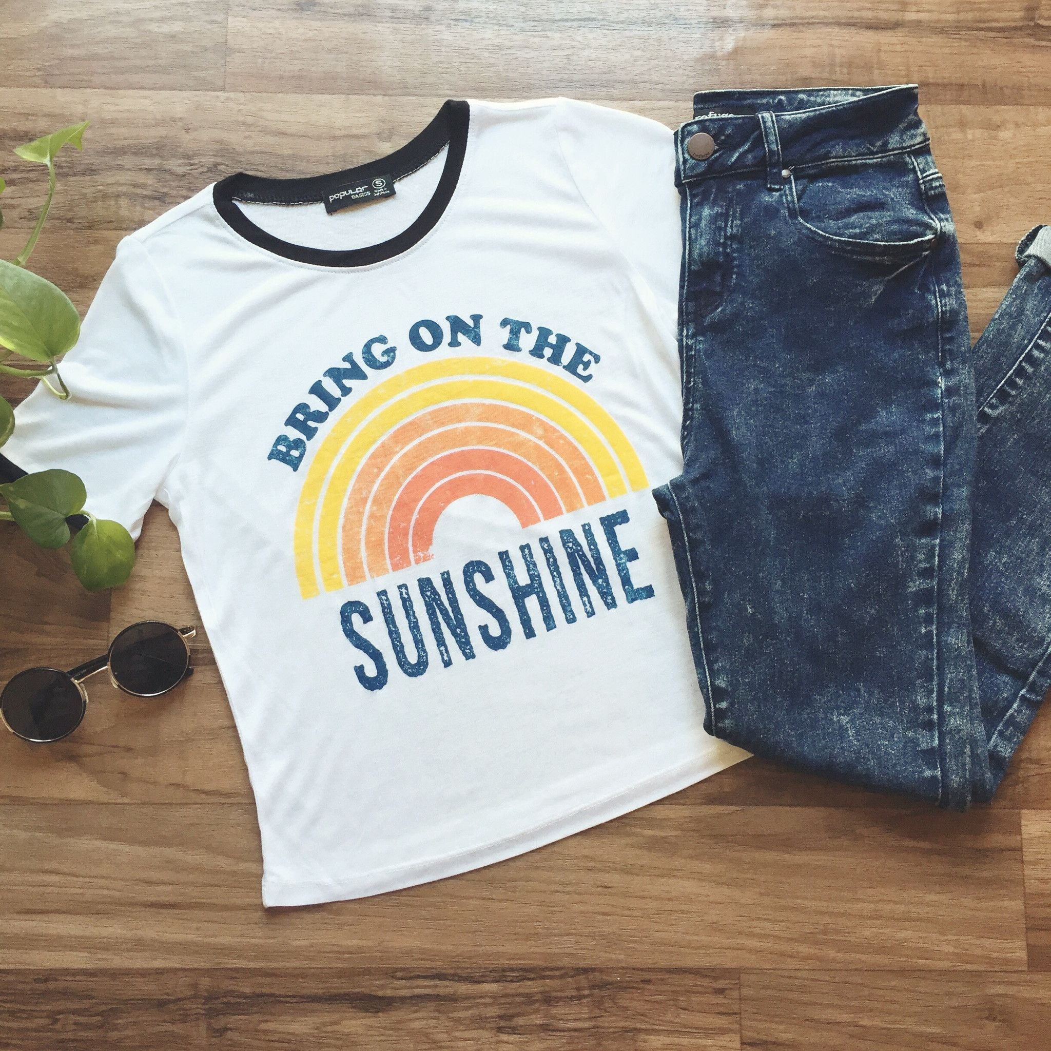 This semi cropped ringer tee features black contrast collar and sleeves and rainbow graphic. We love this light weight tee paired with skinny jeans or cut off shorts! 100% Rayon Find the rest of our t