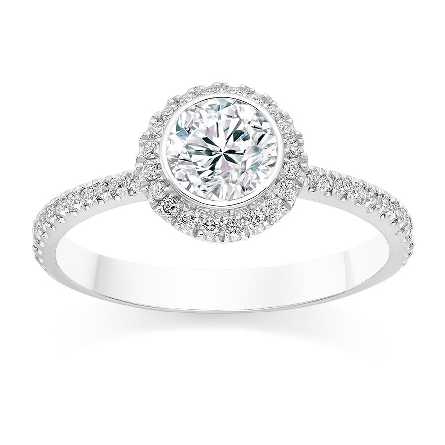I love this Round Cut 0.71 Carat Tapered Halo Diamond Engagement Ring in  18k White Gold
