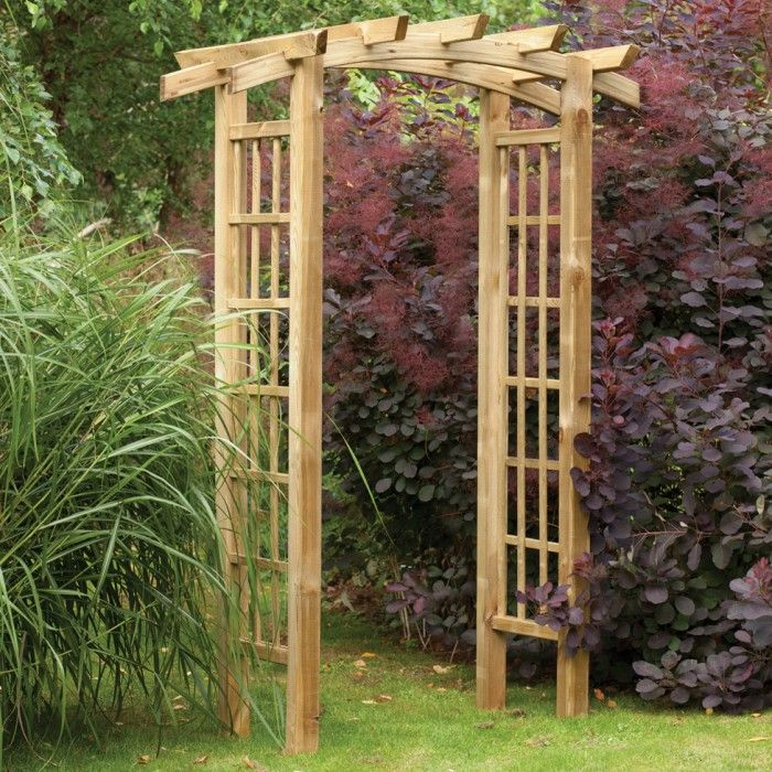 DIY Garden Trellis Out Of Pressure Treated Wood And Cattle Fencing  #gardentrellis