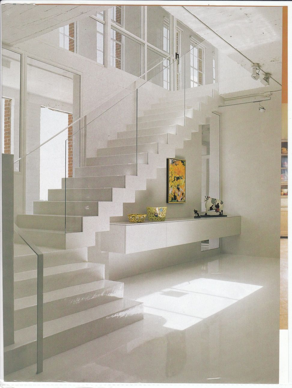 FascinatingWhiteWoodenFloatingStairsWithGlassBanister