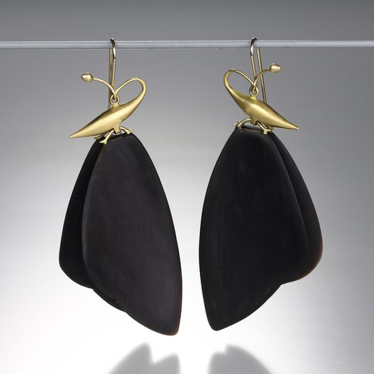 """A pair of 18K yellow gold, double butterfly wing earring with two pieces of carved horn on each. Width, at widest point, measures 1"""". Total length measures 2.5"""". by Gabriella Kiss"""
