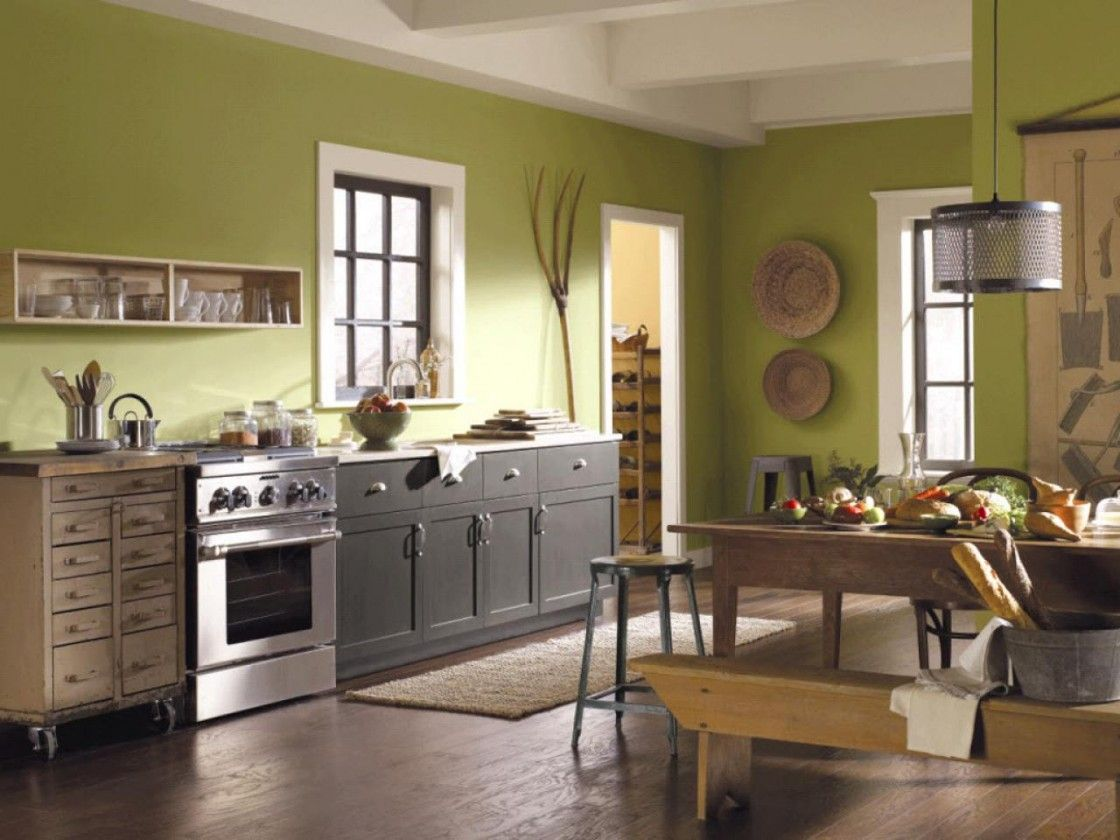 Impressive green wall paint color scheme of small kitchen displaying