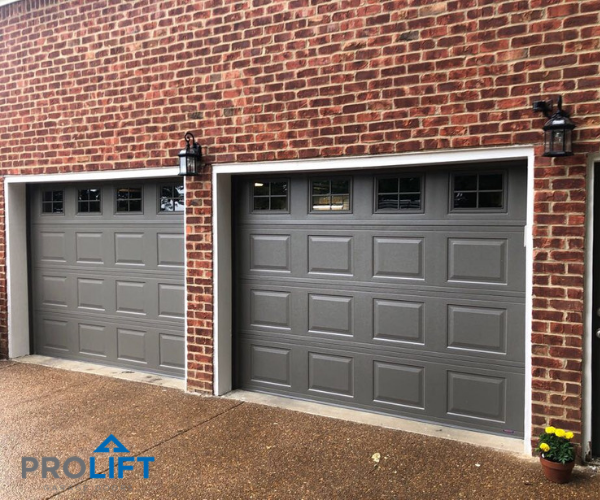 With A Refreshed Color To Complement The Home S Brick And Garage Door Windows With Grilles These Doors Pop Garage Door Styles Garage Door Design Garage Doors