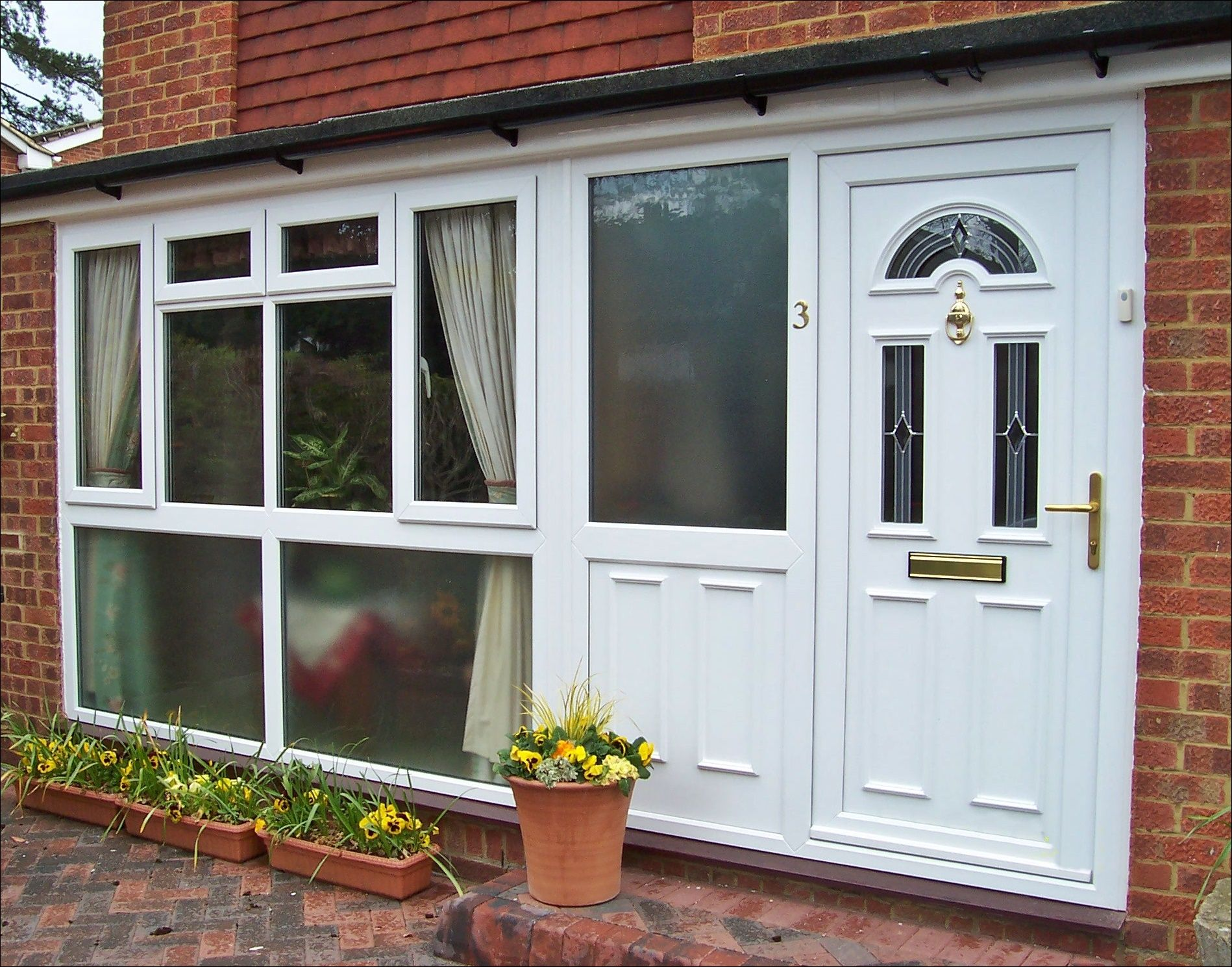 white pvcu windows doors and matching side panel supplied and installed by unicorn windows ltd