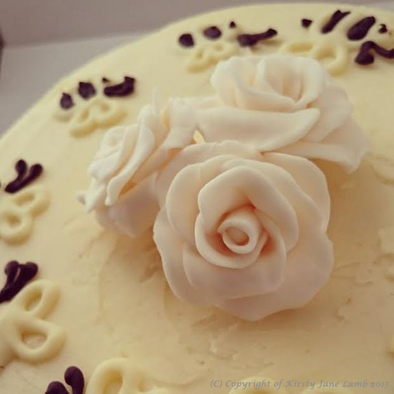 A ring of bees and roses...handmade fondant roses and hand piped chocolate bees to decorate my large honey bun cake with lemon and vanilla buttercream icing...hand made with love xxx would make an interesting alternative wedding cake... x