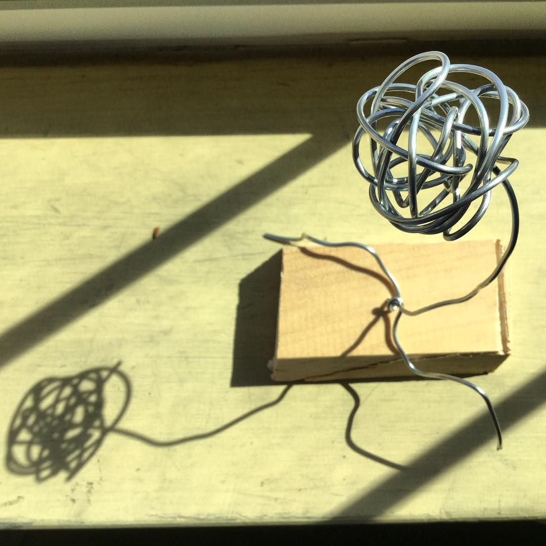 """""""Masked Face"""" Cultivating Creativity student Malik Andrews @lovechildleek placed his wire sculpture by the window so """"it could dry"""". #CreateAtAIC #HigherDedication"""
