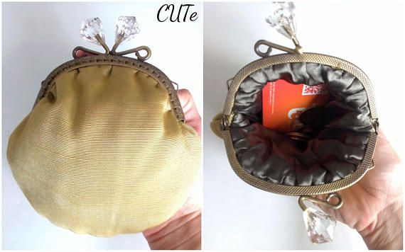 If you have any questions, dont worry, contact me at: madebycute@gmail.com Materials used for this product are: Antique brass coloured kiss lock frame / round finish with diamond closure (11 cm - 4,33 inches) For the outside of the purse, Ive used a yellow iridescent brocade with a stripes design. The inside of the coin purse is sewn with an olive green silky fabric that gives a very special and distinctive touch to the item. All fabric combination matches perfectly with the frame. T...