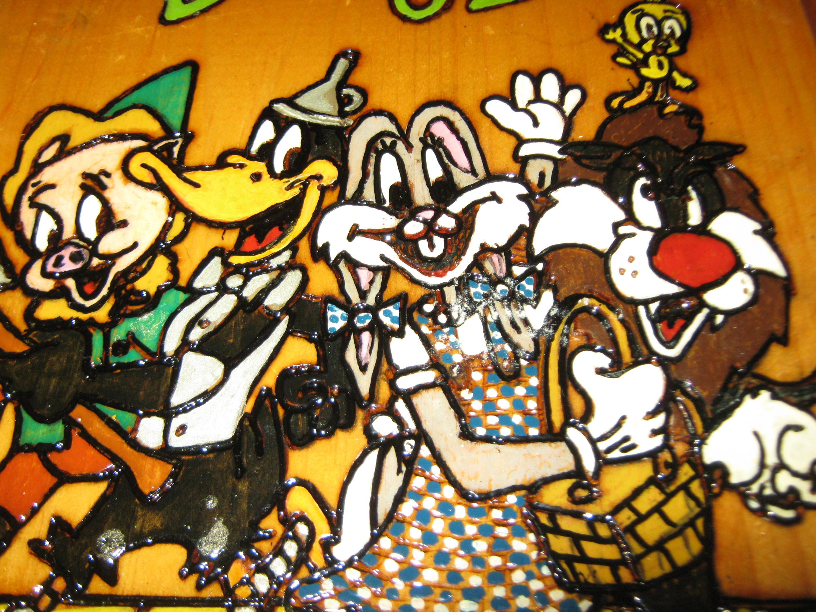This playful plaque has the hand drawn picture of your favorite Looney Tune characters dressed as Dorothy, Tinman, Lion, Scarecrow and Toto from the Wizard of Oz.  Each line of this detailed scene is burned into the wood using wood burning tools. It was stained, hand painted and has a gloss finis...