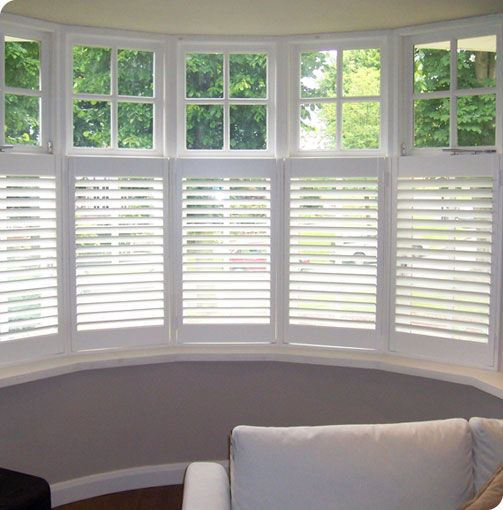 Plantation Shutters Plantation Shutters Prove To Be A Contemporary Covering For Bay Window