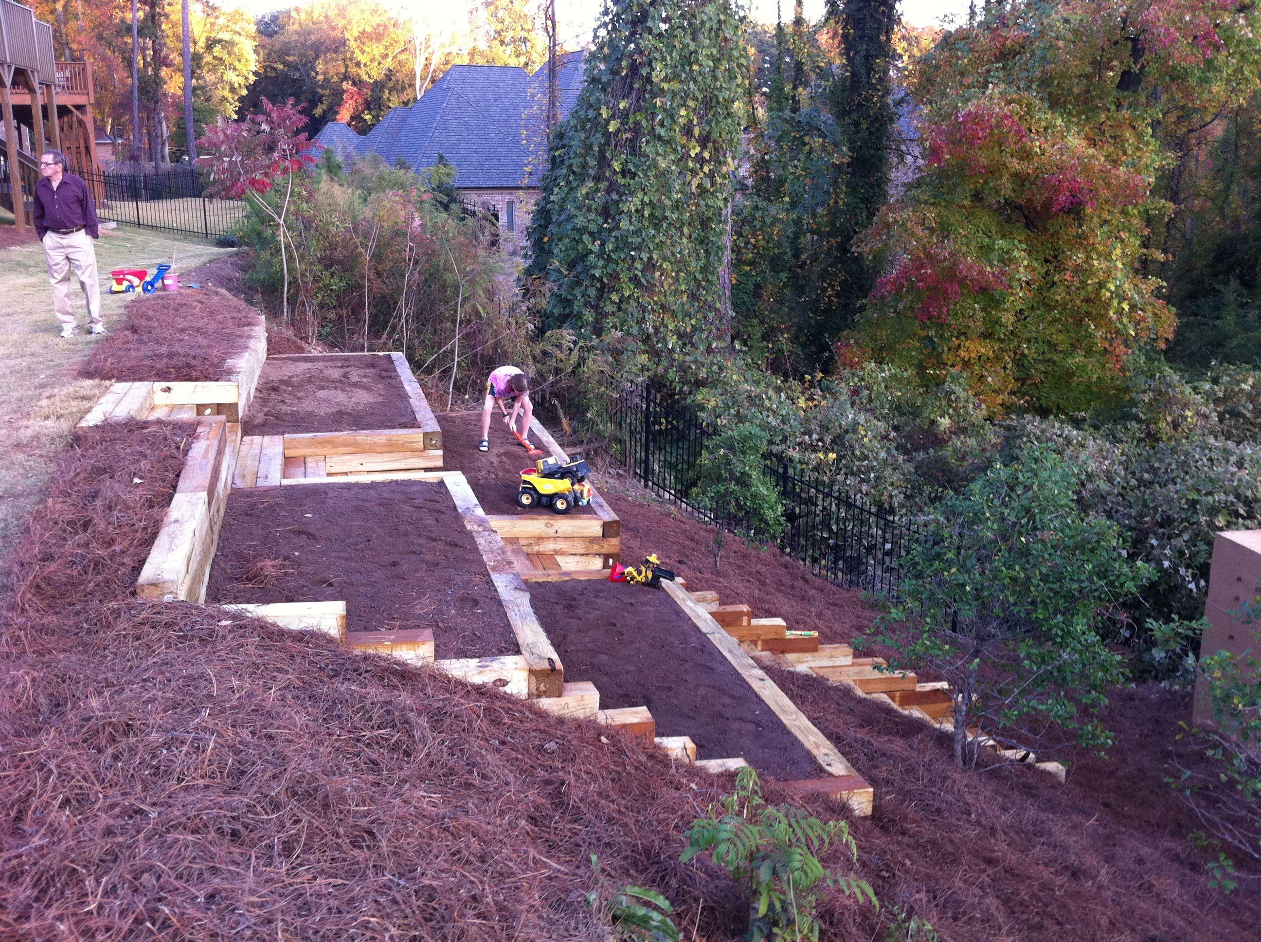 Pretty awesome raised garden beds on a hillside garden