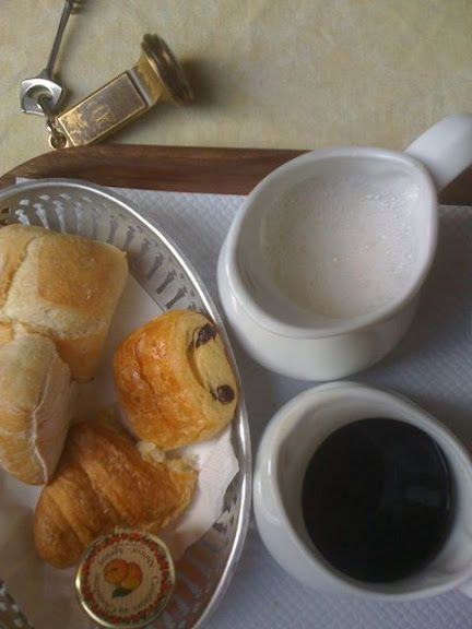 French breakfast with coffee, steamed milk, croissants, pain au chocolat, and more. Perfect start to the day.