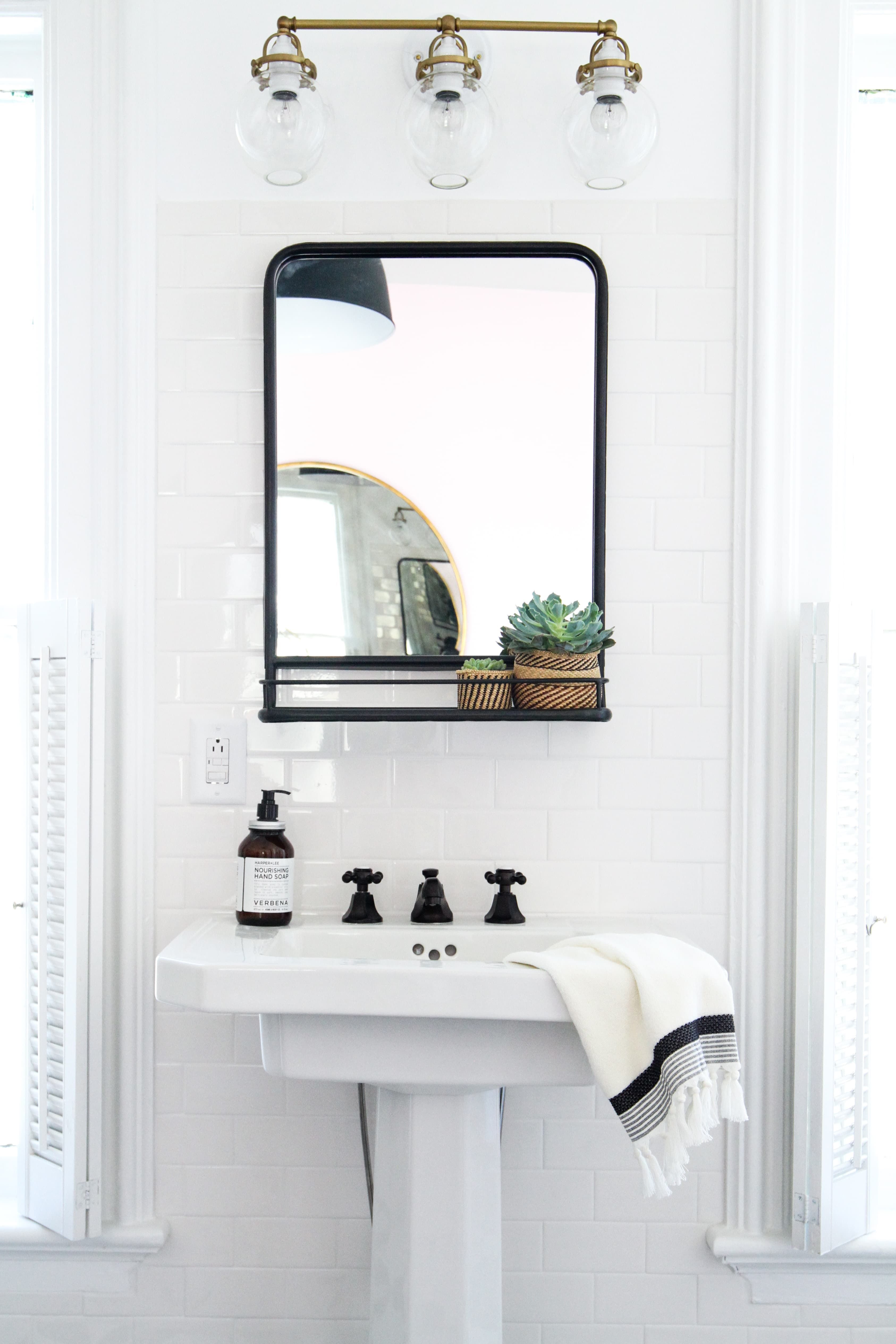 how to hang a bathroom mirror on ceramic tile | serene bathroom