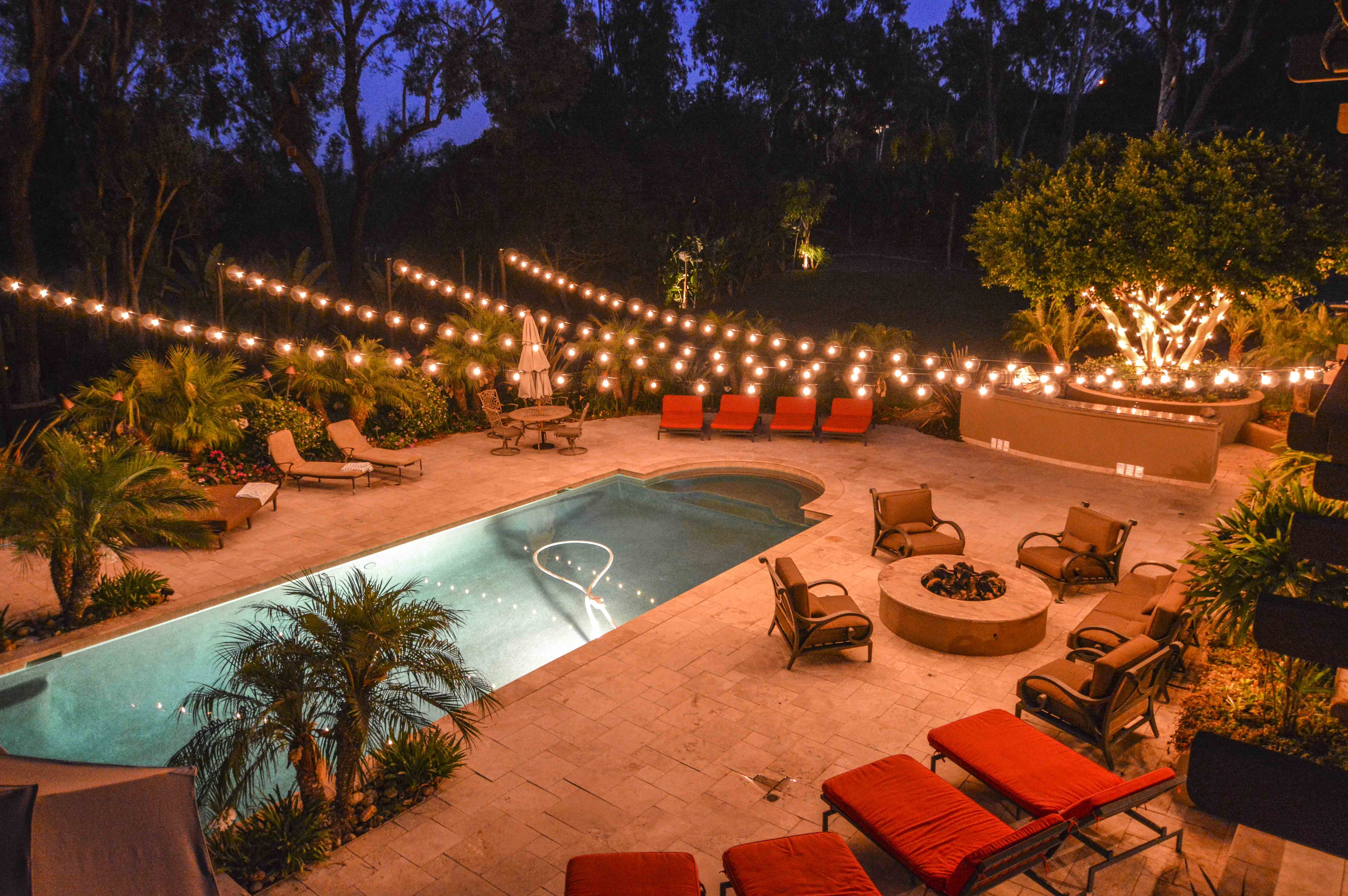 Floating pool lights on pinterest solar pool lights backyard pool - Market Lights At A Backyard Wedding In A Starburst Display Over A Pool